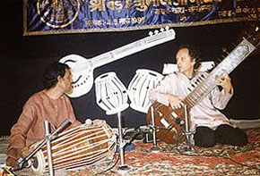 Performing the tarapan with a pakhawaj player at Varanasi music conference in 1994